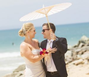 Noosa wedding by the beach. Parasol and sunnies